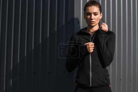 Photo for Attractive young sportswoman posing in thermal clothes - Royalty Free Image