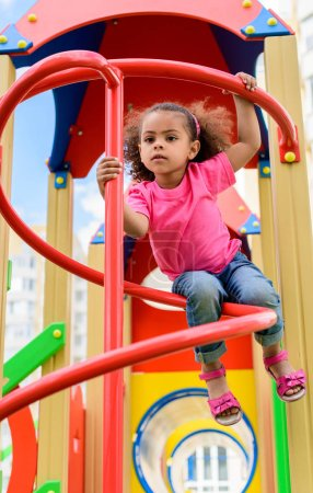 low angle view of curly african american little child having fun at playground