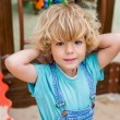 Selective focus of adorable little boy looking at ...