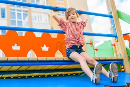 selective focus of smiling little child having fun at playground