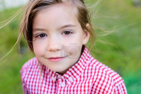 close up portrait of smiling little child on blurred background