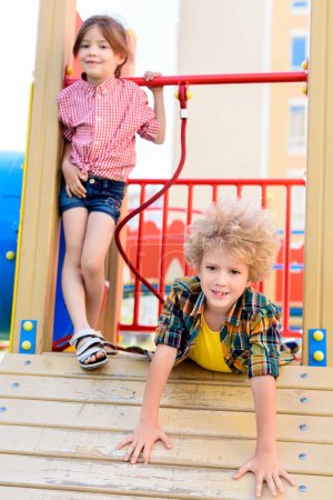 Photo for Selective focus of little brother and sister having fun at playground - Royalty Free Image