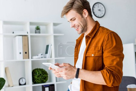 handsome businessman working on startup project in office and using tablet