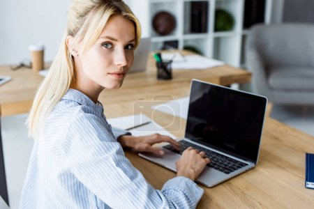 beautiful businesswoman working on startup project in office with laptop