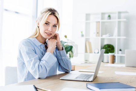 attractive businesswoman working on startup project in office with laptop