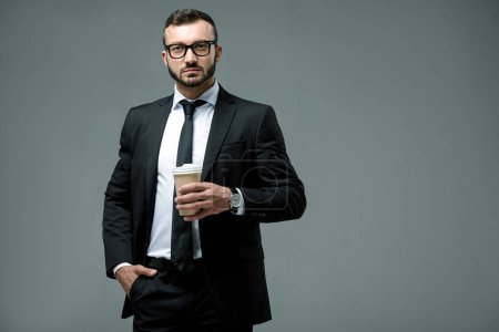 Photo for Handsome businessman with disposable coffee cup isolated on grey - Royalty Free Image
