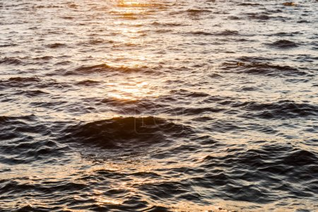beautiful natural background with wavy sea at sunset