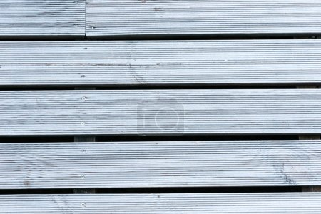 close-up view of grey textured planks background