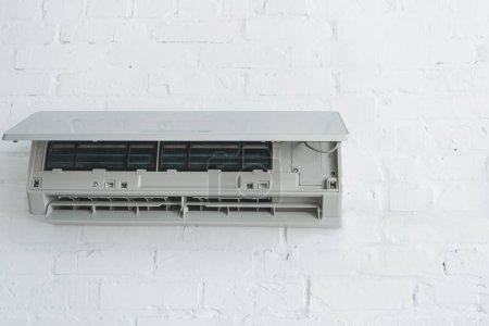 opened air conditioner on white wall at home