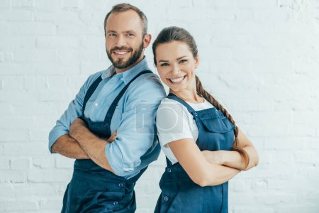 Photo for Smiling confident workers in uniform posing with crossed arms - Royalty Free Image
