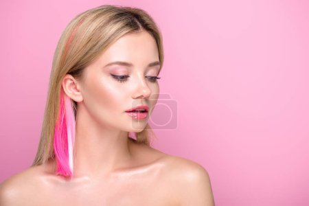 sensual young woman with colorful hair strands isolated on pink