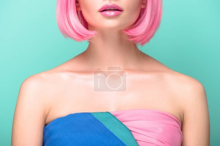 cropped shot of young woman with pink bob cut isolated on turquoise