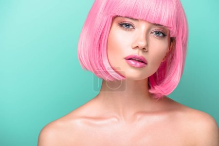 Photo for Attractive young woman with pink bob cut and stylish makeup looking at camera isolated on turquoise - Royalty Free Image