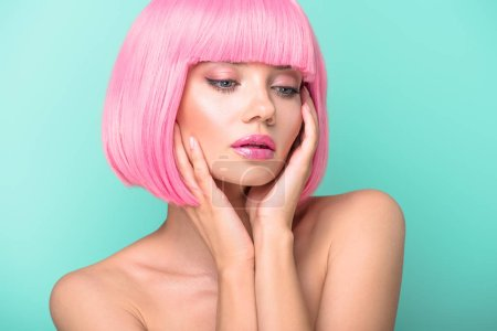 sensual young woman with pink bob cut isolated on turquoise