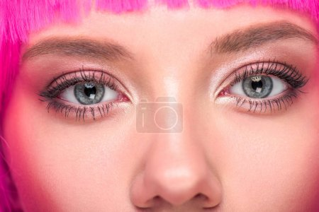 partial view of beautiful young woman with pink hair looking at camera