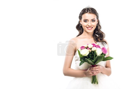 close-up portrait of young bride in wedding dress with earrings and tiara holding bouquet isolated on white