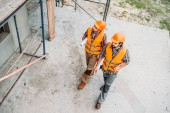 high angle view of builders walking at construction site
