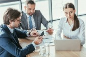 confident young business partners working together at modern office