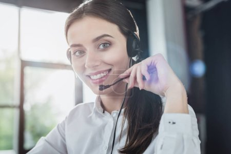 beautiful female call center worker with headphones looking at camera