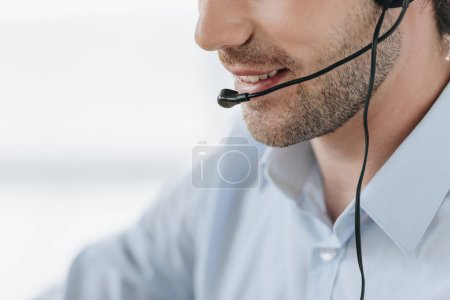 cropped shot of smiling support hotline manager at work