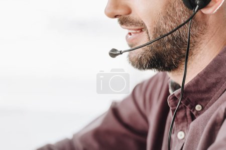 Photo for Cropped shot of call center worker with microphone - Royalty Free Image