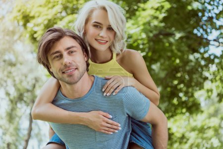 Photo for Boyfriend giving piggyback to girlfriend in park - Royalty Free Image