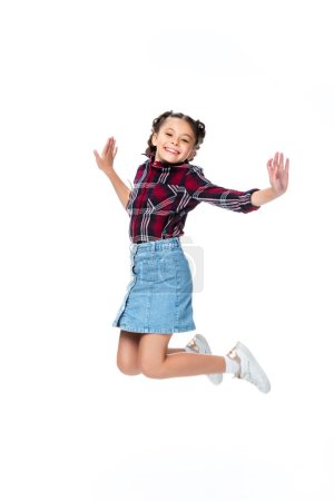 happy schoolchild jumping isolated on white