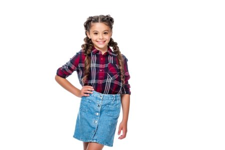 schoolchild in denim skirt and checkered shirt posing isolated on white