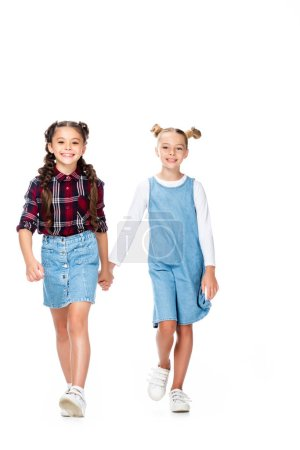 schoolchildren walking and holding hands isolated on white