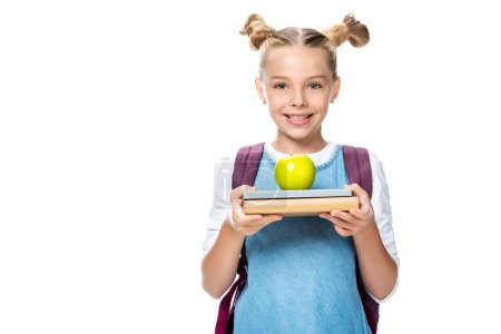 schoolchild holding apple on books isolated on white