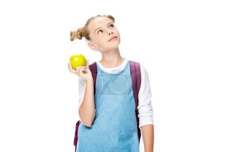 schoolchild holding apple and looking up isolated on white