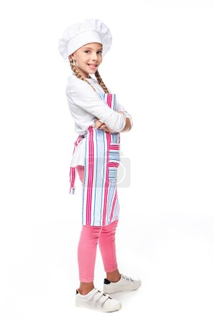 schoolchild in costume of chef standing with crossed arms isolated on white