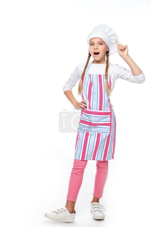 surprised schoolchild in costume of chef showing idea gesture isolated on white