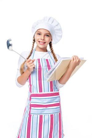 schoolchild in costume of chef holding ladle and cookbook isolated on white