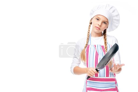 schoolchild in costume of chef holding frying pan isolated on white