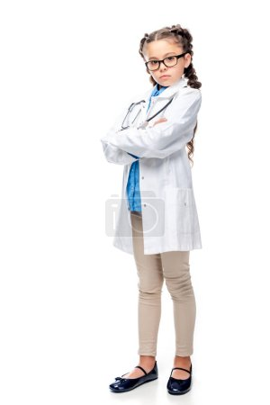 Photo for Serious schoolchild in white coat standing with crossed arms isolated on white - Royalty Free Image