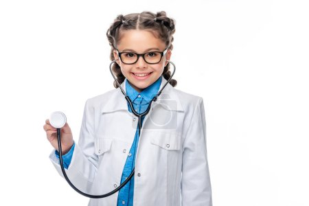 schoolchild in costume of doctor listening with stethoscope isolated on white