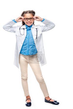 schoolchild in costume of doctor posing isolated on white