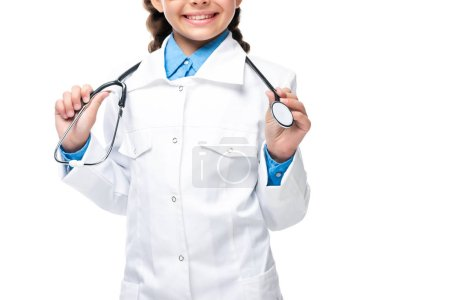 cropped image of schoolchild in white coat holding stethoscope isolated on white