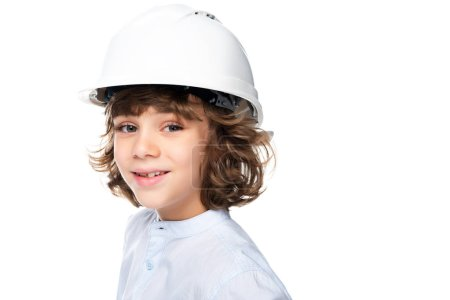 portrait of schoolboy in costume of architect and helmet isolated on white