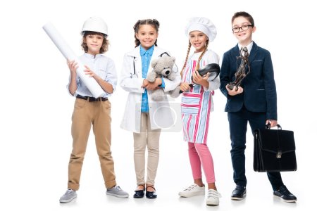 happy schoolchildren in costumes of different professions isolated on white