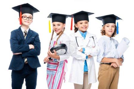 Photo pour Écoliers en costumes de différentes professions et casquettes de graduation isolés sur blanc - image libre de droit