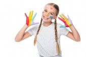 smiling schoolchild showing colored painted hands isolated on white