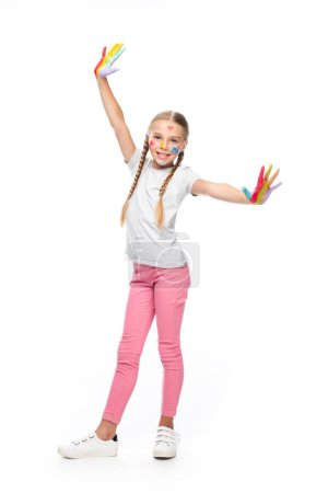smiling schoolchild standing with painted open arms isolated on white and looking at camera