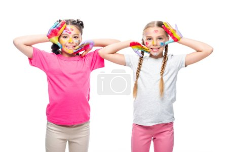 schoolchildren touching faces with painted hands isolated on white