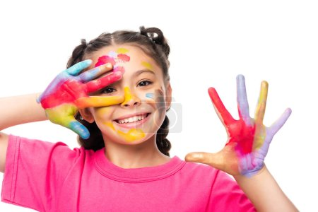 happy schoolchild showing painted hands isolated on white