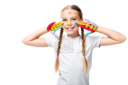 smiling schoolchild showing painted hands with smiley icons isolated on white