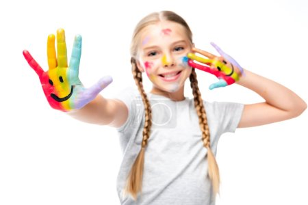happy schoolchild showing painted hands with smiley icons isolated on white