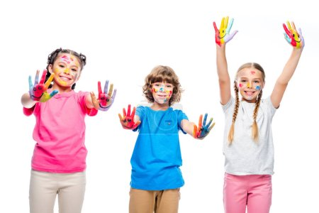 Photo for Three classmates having fun and showing painted hands with smiley icons isolated on white - Royalty Free Image