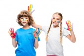 two classmates having fun and showing painted hands with smiley icons isolated on white